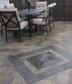 Interlocking brick patio with inlay