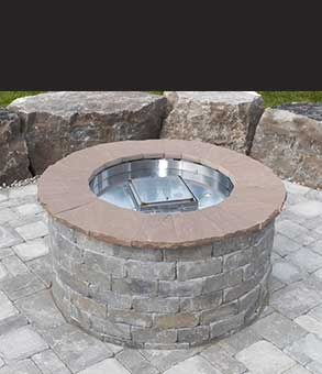 We install natural stone backyard fire pits like this one